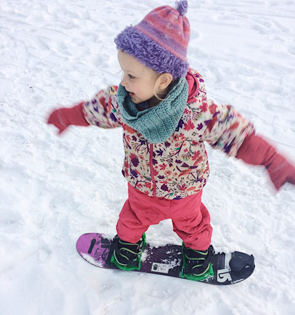 teaching a toddler to snowboard born to be adventurous